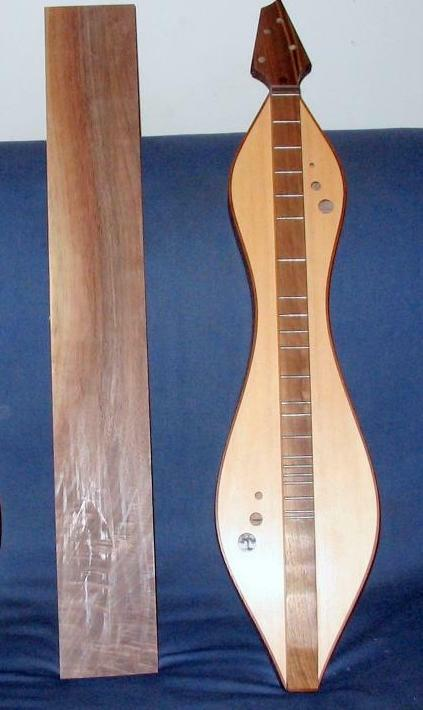walnut board and a dulcimer