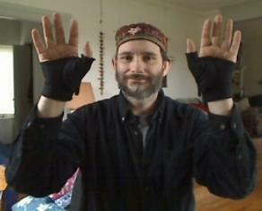 Doug Berch shows off his stylish thumb braces
