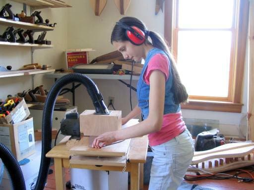 Anna at the thickness sander