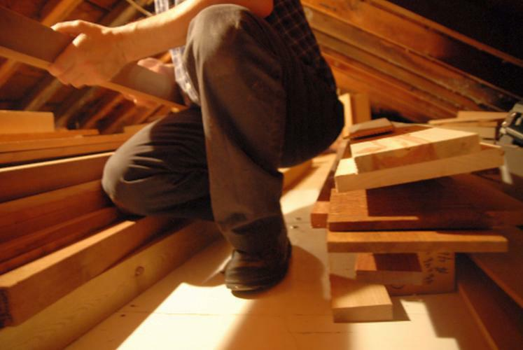 sorting wood in the attic