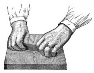 Disembodied hands using a card scraper