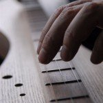Fingers and fretboard like hot dogs and mustard 150x150 On Line Fret Placement Calculators