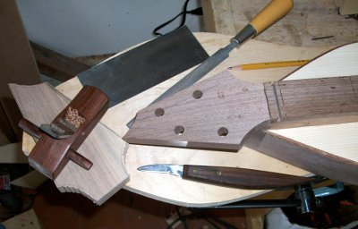 Tools used for trimming, fitting and shaping the peghead.