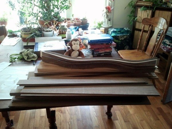 My apprentice sorts sides and backs for the next run of dulcimers When Dulcimer Making Takes Over The House