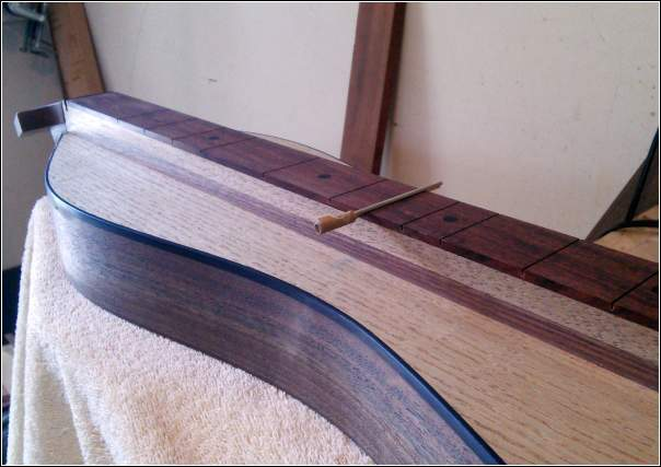 Tool for measuring depth of a fret slot