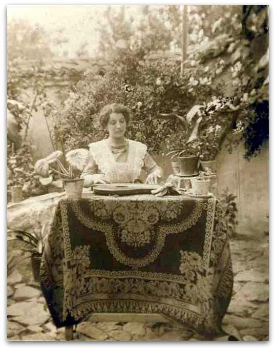 Woman playing zither in a garden