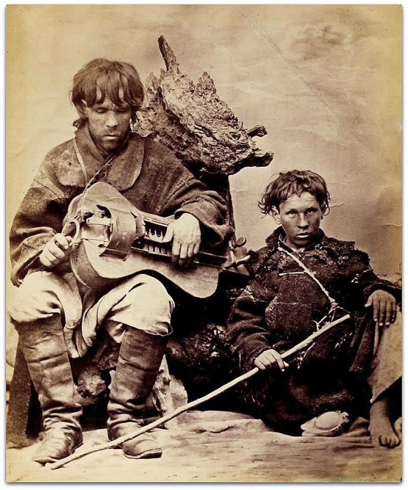 Hurdy-Gurdy player and traveling friend