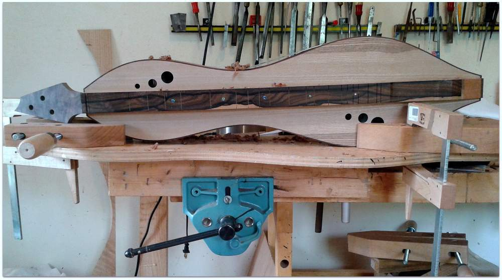 Cleaning up the sides of a dulcimer with a scarper!