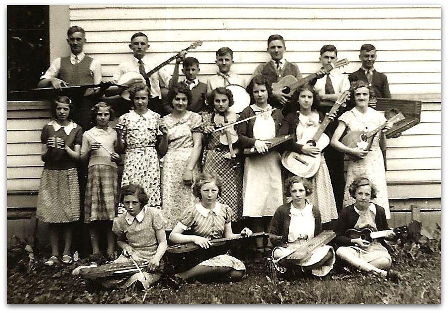 School band with ukelins, zithers, Hawaiian guitars, guitar, banjos, bones, flute and mandolin.