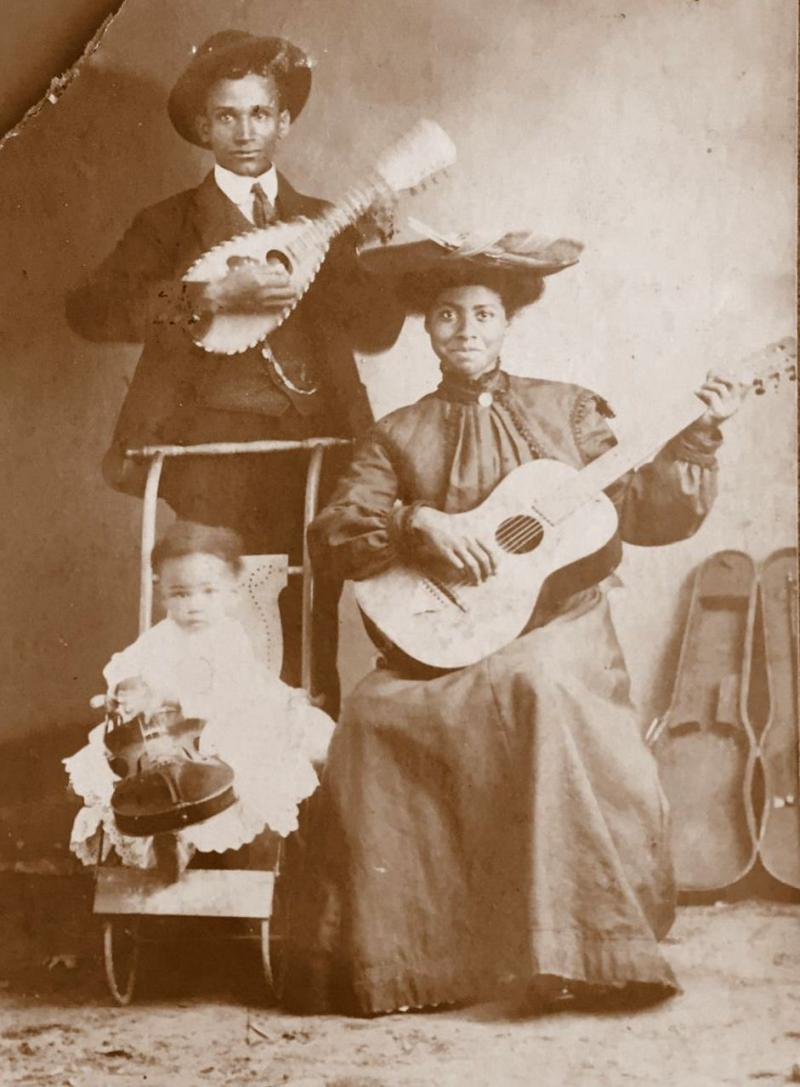 Beautiful family with guitar, mandolin, and fiddle.