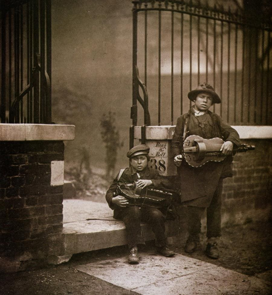 Two young hurdy gurdy players in the late 1800's