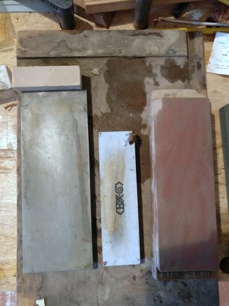 Sharpening stones and a stinkbug