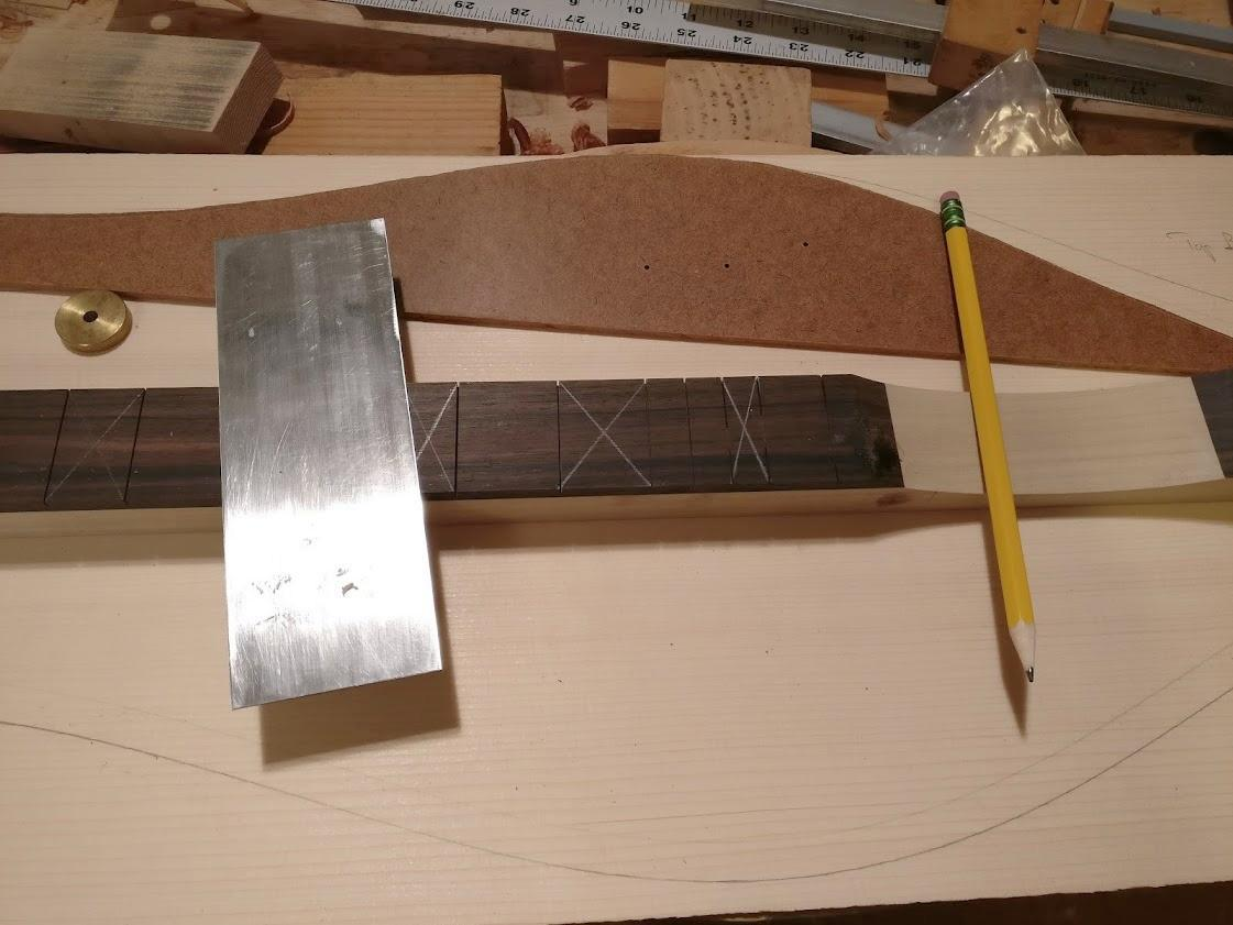 Laying out position markers and soundholes on a baritone dulcimer